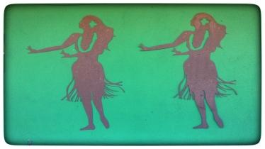 iron Aloha girls mounted on green wall